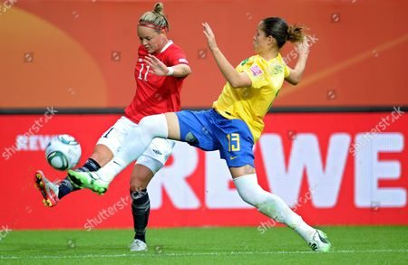 Stock Image of Erika (r)áof Brazil and Leni Larsen Kaurin of Norway Fight For the Ball During the Group D Match Brazil Against Norway of Fifa Women's World Cup Soccer Tournament at the Arena Im Allerpark Wolfsburg Germany 03 July 2011 Germany Wolfsburg