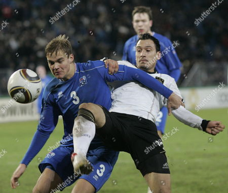 Stock Photo of Germany's Timo Gebhardt (r) and Iceland's Holmar Orn Eyjolfsson (l) Vie For the Ball During the Uefa Under-21 Qualifier Germany Vs Iceland in Magdeburg Germany 02 March 2010 the Match Ended in a 2-2 Draw Germany Magdeburg