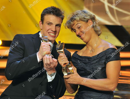 German Swimmer Paul Biedermann (l) and German Javelinist Steffi Nerius Pose with Their Trophies During the 'Sportsman of the Year' Gala in Baden Baden Germany 20 December 2009 Germany Baden-baden