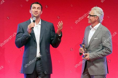 Klitschko's Manager Bernd Boente (r) and Ukrainian Heavyweight Boxer Vladimir Klitschko (l) Deliver a Spech After Klitschko Management Group (kmg) Won the Category 'Best Sportsmarketing' at the 'Sport Bild' Awards Ceremony in Hamburg Late 08 August 2011 Europe's Largest Sports Magazin Sport Bild Honors Athletes and People Associated with Sports with the 'Sport Bild' Awards For the 8th Time Germany Hamburg