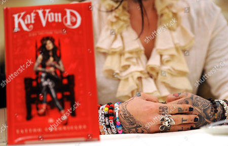 Stock Picture of View of the Hands of Us Tattoo Artist Kat Von D (katherine Von Drachenberg) During the Presentation of Her New Book 'Tattoo Chronicles' at a Press Conference at Hotel Regent in Berlin Germany 06 December 2010 Kat Von D Writes About Her Life and Tattoo Art Germany Berlin