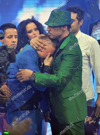 Singer Mehrzad Marashi (r) Embraces the Second Finalist Menowin Froehlich (l) After He Won the Rtl Tv Show 'Deutschland Sucht Den Superstar' (dsds) in Cologne Germany 17 April 2010 Germany Cologne