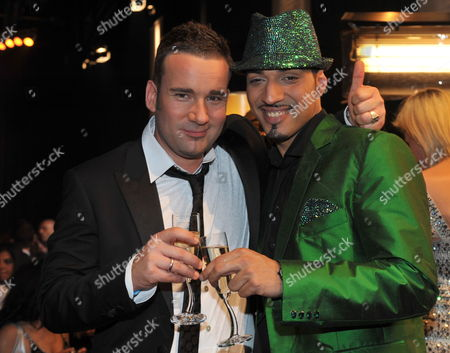 Stock Image of Singer Mehrzad Marashi (r) Poses For Photographs with Jury Member and German Music Manager Volker Neumueller (l) After He Won the Finals of the Rtl Tv Show 'Deutschland Sucht Den Superstar' (dsds) in Cologne Germany 17 April 2010 Germany Cologne