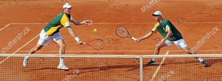 South Africa's Wesley Moodie (l)áand Rik De Voest (r)áin Action During Their Davis Cup Relegation Match Against Germany's Beck/kas in Stuttgart Germany 18 September 2010 Germany Stuttgart