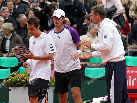 Germany's Team Captain Patrick Kuehnen (r) Speaks with Players Philipp Kohlschreiber (l) and Christopher Kas During the Tennis World Team Cup Match Against French Chardy and Mahus (unseen) at the Rochusclub in Duesseldorf Germany 17 May 2010 Germany Duesseldorf