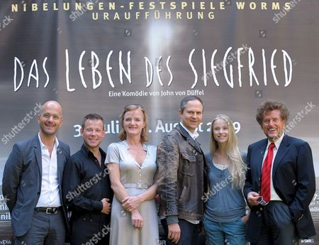 Dieter Wedel (r) Artistic Director of the Nibelungen Festival Director Gil Mehmert (4-l) Actors Christoph Maria Herbst As 'Hagen' (l) and Mathias Schlung As 'Seefred' (2-l) and Actresses Nina Petri As 'Bruenhild' (3-l) and Susanne Bormann As 'Kriemhild' (5-l) Pose in Front of a Poster of the Festival During a Press Conference in Worms Germany 22 May 2009 the Comedy 'The Life of Siegfried' by Best-selling Author John Von Dueffel Will Be Staged For the First Time Between 31 July and 16 August 2009 Germany Worms