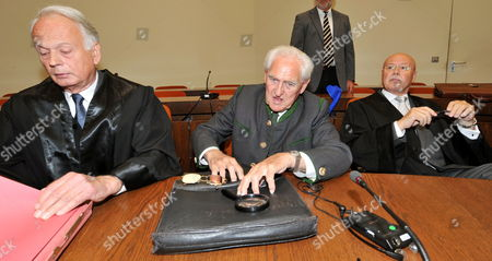 Defendant Josef Scheungraber (c) is in the Dock Between His Solicitors Christian Stuenkel (l) and Rainer Thesen (r) As His Verdict is Scheduled to Be Proclaimed in Munich Germany 11 August 2009 Scheungraber 90-years-old and Former Company Commander of Mountain Infrantry Battalion 818 During Wwii is Charged with Multiple Murder in June 1944 He Allegedly Commanded to Kill 14 Italian Civilians in Italy's Tuscany Region in a Retaliatory Strike For Two German Soldiers Killed During a Partisan Ambush the Verdict on Scheungraber Expected For 11 August is Postponed the Court Proceeded to Take Evidence Again Germany Munich