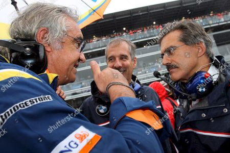 German Dr Mario Theissen (r) Bmw Motorsport Director of Bmw Sauber Talks to Italian Flavio Briatore (l) Team Director of Renault Prior to the Italian F1 Grand Prix Race at the Circuit in Monza Near Milan 14 September 2008 Italy Monza