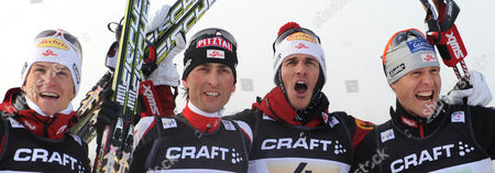 Austrian Team Members Mario Stecher (2nd L) David Kreiner (l) Felix Gottwald (2nd R) and Bernhard Gruber (r) Celebrate Their Victory in the Nordic Combined Team Competition During the Fis Nordic Skiing World Championships in the Holmenkollen Ski Arena Near Oslo Norway 28 February 2011 Norway Oslo