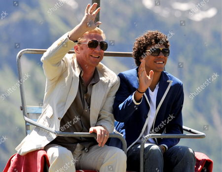 Stock Photo of German Tennis Legend Boris Becker (l) and His Son Noah Gabriel Are on the Way to Alpine Hut 'El Paradiso' in St Moritz Switzerland 13 June 2009 the Restaurant Hosts the Closing Brunch After the Wedding of German Tennis Legend Boris Becker and Fiancee Sharlely 'Lilly' Kerssenberg the Couple Married on 12 June Switzerland Schweiz Suisse St. Moritz