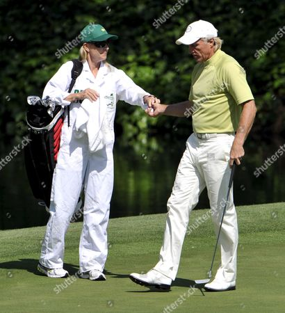 Stock Photo of Greg Norman of Australia (r) Gets His Ball From Wife and Caddie Chris Evert on the Eighth Hole During the the Par 3 Tournament on the Final Day of Practice For the 2009 Masters Tournament at Augusta National in Augusta Georgia Usa 08 April 2009 the Masters Begins on 9 April 2009 United States Augusta