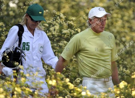 Greg Norman of Australia (r) Walks with Wife and Caddie Chris Evert on the Eighth Hole During the the Par 3 Tournament on the Final Day of Practice For the 2009 Masters Tournament at Augusta National in Augusta Georgia Usa 08 April 2009 the Masters Begins on 9 April 2009 United States Augusta