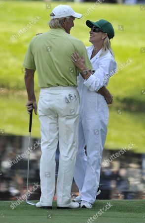 Greg Norman of Australia (l) Gets an Embrace From Wife and Caddie Chris Evert on the Ninth Hole During the the Par 3 Tournament on the Final Day of Practice For the 2009 Masters Tournament at Augusta National in Augusta Georgia Usa 08 April 2009 the Masters Begins on 9 April 2009 United States Augusta