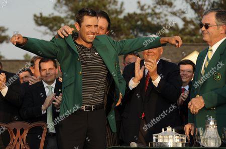 Phil Mickelson of the Us (b) Helps Charl Schwartzel of South Africa Into His Green Jacket As Masters Chairman Bill Payne (r) Looks on at Augusta National Golf Club During the 2011 Masters Tournament in Augusta Georgia Usa 10 April 2011 Schwartzel Won the Masters by Two Strokes Over Jason Day and Adam Scott of Australia United States Augusta