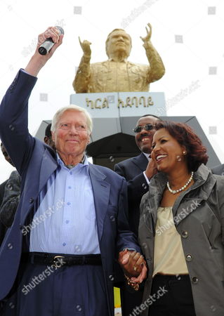 Austrian Actor and Founder of the 'People For People' Foundation Karlheinz Boehm (l) and His Wife Almaz Boehm Stand in Front of a Sculpture with Boehm's Likeness Unveiled During the Inauguration of 'Karl Square' in Addis Ababa áethiopia 23 June 2011 the 'Karl Square' in the City's Diplomatic Quarter Honors 83-year-old Karlheinzáboehm's Humanitarian Work Ináethiopia Ethiopia Addis Ababa
