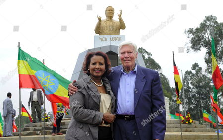 Austrian Actor and Founder of the 'People For People' Foundation Karlheinz Boehm (r) and His Wife Almaz Boehm Stand in Front of a Sculpture with Boehm's Likeness Unveiled During the Inauguration of 'Karl Square' in Addis Ababa áethiopia 23 June 2011 the 'Karl Square' in the City's Diplomatic Quarter Honors 83-year-old Karlheinzáboehm's Humanitarian Work Ináethiopia Ethiopia Addis Ababa