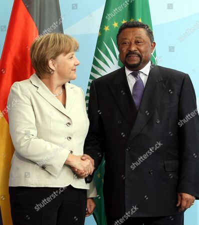 German Chancellor Angela Merkel (r) and the Chairman of the Commission of the African Union Jean Ping Shake Hands As They Meet at the Chancellery in Berlin Germany 05 July 2011 Ping was Earlier Welcomed with Full Military Honors Germany Berlin