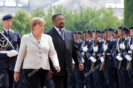 German Chancellor Angela Merkel (l) Receives the Commission President of the African Union Jean Ping (c-r) with Military Honours at the Chancellory in Berlin Germany 5 July 2011 Germany Berlin