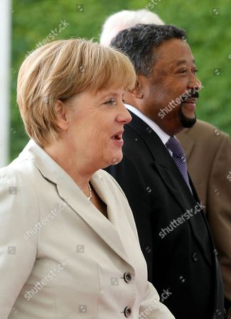 German Chancellor Angela Merkel (l) Receives the Commission President of the African Union Jean Ping (r) with Military Honours at the Chancellory in Berlin Germany 5 July 2011 Germany Berlin
