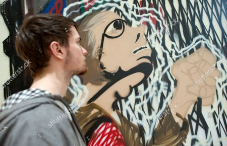 A Young Man Look at an Artwork Entitled Deadly Solitaire by Artist Lee Quinones in Stuttgart ágermany 18 February 2011 Works by Graffiti Artists From New York From the 1980s Are on Display at the Kunstmuseum Stuttgart From 01 May 2011 on Germany Stuttgart