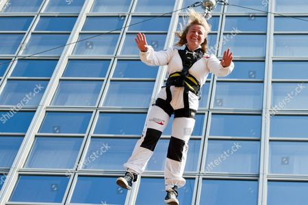 Germany's Blind Cross Country Skier Verena Bentele Five-time Gold Medal Winner at the Vancouver 2010 Paralympic Games Takes Part in a Base Jumping Event in Downtown Berlin Germany 19 April 2011 Germany Berlin