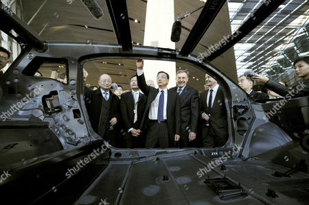 Bmw Chairman of the Board Norbert Reithofer (2-r) the Responsible Engineer For New Mobility Concepts Ulrich Kranz (r) Present an Autobody That is Made of Carbon Fiber to the Chinese Vice Prime Minister Li Kequiang (c) During a Visit to the Bmwáworld in Munich Germany 08 January 2011 Reports State That Vice Premier Li Kequiang is on a Visit to Europe Which Includes Spain Germany and Britain Germany Munich