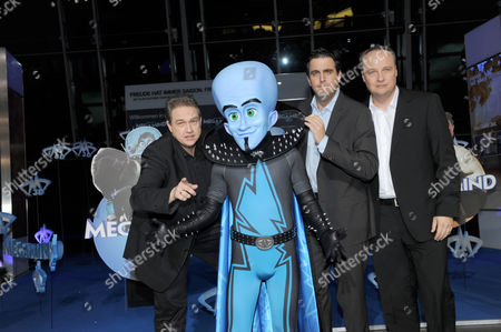 German Satiriste Oliver Kalkofe (l) German Actor Bastian Pastewka (c) and German Author Oliver Welke (r) Pose with the Animated Film Character 'Checker' at the Premiere of the Film 'Megamind' at Olympiapark in Munich ágermany 21 November 2010 the 3rd Animated Comedy Movie German Theatrical Release Date is on 02 December 2010 Germany Munich