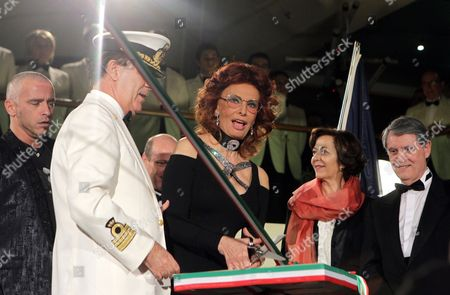 Italian Actress and Godmother of the Ship Sophia Loren Cuts the Ribbon As Italian Singer Eros Ramazzotti (l) Captain Giuliano Bossi (2-l) French Minister of State For Foreign Trade Anne-marie Idrac (2-r) and Msc Cruises Chief Executive Pierfrancesco Vago (r) Look on During the Official Christening Ceremony of the New Ship 'Msc Magnifica' in Hamburg Germany 06 March 2010 'Msc Magnifica' the 11th in the Fleet and 4th in the Musica Class of Ships Offers 22 000 Square Meters of Public Areas For Some 3 000 Guests Germany Hamburg