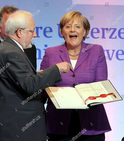 (l-r)ágdr's Last Prime Minister Lothar De Maiziere and German Chancellor Angela Merkel Smile with the German Unification Treaty During a Ceremonial Act on the Occasion of the 20th Anniversary of Signing the German Unification Treaty in Berlin Germany 31 August 2010 Germany Berlin