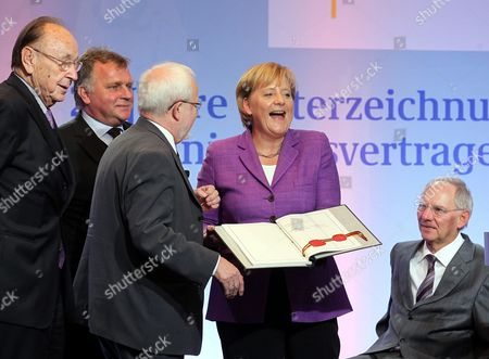 (l-r)áformer German Foreign Minister Hans-dietrich Genscher Former Gdrástate Secretary Guenther Krause Gdr's Last Prime Minister Lothar De Maiziere German Chancellor Angela Merkel and German Minister of Finance Wolfgang Schaeuble Then Minister of Interiors Smile with the German Unification Treaty During a Ceremonial Act on the Occasion of the 20th Anniversary of Signing the German Unification Treaty in Berlin Germany 31 August 2010 Germany Berlin