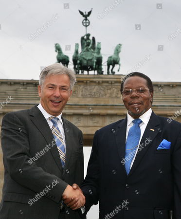 Malawi's President Bingu Wa Mutharika (r) is Greeted by the Mayor of Berlin Klaus Wowereit in Front of the Landmark Brandenburg Gate in Berlin Germany 02 September 2010 Mutharaki is in Germany For a Few Days on an Official State Visit Germany Berlin