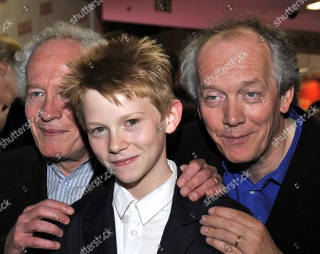 Belgian Director Brothers Jean-pierre (l) and Luc Dardenne Arrive with There Leading Actor Thomas Doret (c) For the Premiere of the Opening Film of the Munich Film Festival 'Le Gamin Au Velo' (the Kid with a Bike) at the Mathaeser Filmpalast in Munich Germany 24 June 2011 the 29th Film Festival Runs Until 02 July 2011 and Will Show Over 200 Films From 52 Countries Germany Munich