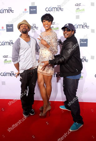 Members of the Norwegian Hip Hop and Reggae Band Tshawe Baqwa (l) and Yosef Wolde-mariam (r) Pose For a Photograph with an Unidentified Woman As They Arrive at the Award Ceremony of the Viva Comet 2011 in Oberhausen Germany 27 May 2011 the 16th Award of the German Music Prize That is Given to National Artists Takes Place in Oberhausen For the Fifth Time Germany Oberhausen