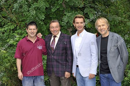 Harmonica Player Michele Hirte (l-r) Czech Singer Karel Gott German Folk Music Presenter and Singer Florian Silbereisen and French Pianist Richard Clayderman Pose During the Press Conference For the 2011 Tour of the Live Television Show 'The Spring Festival of Folk Music' in Munich Germany 17 September 2010 the Show Will Be Hosted by Florian Silbereisen and Visit Five Countries and Over 40 Cities Germany Munich