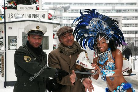 Lou Bega (c) a Costumed Dancer of 'Holiday on Ice' and a 'Border Guard' That Put Bega Under Fake Arrest Pose at the Checkpoint Charlie in Freezing Temperatures in Berlin Germany 02 December 2010 Bega is Promoting the 'Holiday on Ice' Show 'Tropicana' That Will Take Place in 23 German Cities Until March 2011 Germany Berlin