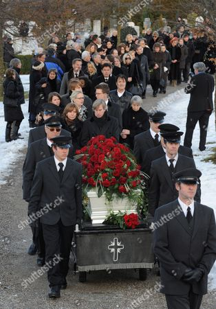 Stock Image of The White Coffin of Deceased German Tv Presenter Petra Schuermann is Carried Through the Cemetery in Aufkirchen Germany 19 January 2010 Schuermann Died at Age 74 on 14 January 2010 Germany Aufkirchen