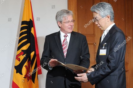Interim German President and President of the Federal Council Jens Boehrnsen (l) Presents the Certificate of the Philipp Franz Von Siebold-prize to the Japanese Art Historian Jun Tanaka (r) at the Bellevue Palace in Berlin Germany 22 June 2010 the Prize is Endowed with 50 000 Euros and the Awardee is Invited to Spend a Year of Research in Germany Germany Berlin