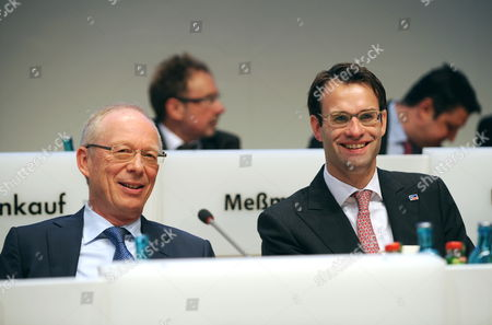 Stock Picture of Guenther Cramer (l) Still Acting Ceo of Smaásolar Technology Smiles During a Shareholders' Meeting Next to His Successor Pierre-pascal Urbon (r) in Kassel ágermany 26 May 2011 Cramer Will Probably Change to the Supervisory Board of Sma the World Leader in the Manufacturing of Inverters For Solar Power Systems Germany Kassel