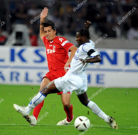 Stock Image of Karlsruhe Sc's Godfried Aduobe (r) Vies For the Ball with 1 Fc Cologne's Pedro Tonon Geromel (l) During Their German Bundesliga Soccer Match 29 August 2008 (attention: Embargo Conditions! the Dfl Permits the Further Utilisation of the Pictures in Iptv Mobile Services and Other New Technologies No Earlier Than Two Hours After the End of the Match the Publication and Further Utilisation in the Internet During the Match is Restricted to Six Pictures Per Match Only ) Germany Karlsruhe