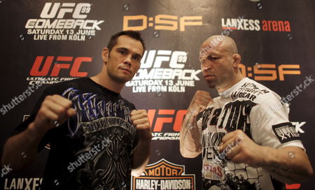 Stock Photo of Brazil's Wanderlei Silva (r) and Usa's Rich Franklin (l) Pose During a Press Conference in Cologne Germany 11 June 2009 Ahead of Their Cage Fight in the Ultimate Fighting Championship (ufc) on 13 June Two Opponents Fight in a Steel Cage Without Any Protection Using Mixed Martial Arts the Ufc Came Into Being in 1993 in the United States Germany Cologne