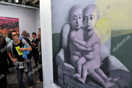 A Visitor of the Pre-viewing of the Art Fair 'Art 41' Looks at the Photo 'Green Wall - Two Babies' by Artist Zhang Xiaogang at a Stand of Gallery the Pace in Basel Switzerland 15 June 2010 on 16 June 2010 the International Art Fair 'Art 41' Will Begin For the 41st Time Over 300 Galleries From 37 Countries Show Works of Over 2 500 Artists of the 20th and 21st Century Switzerland Schweiz Suisse Basel
