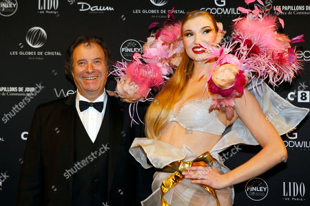 French actor Daniel Russo poses during a photo call at the Lido cabaret on the Champs Elysees, to take part in the Crystal Globes awards ceremony in Paris