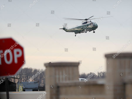 """Marine One, with President Donald Trump, lands at Dover Air Force Base, Del. . Trump traveled to Dover AFB to meet with family members Chief of Special Warfare Operator William """"Ryan"""" Ownes, 36, of Peoria, Ill, the U.S. service member who was killed in a raid in Yemen, and who's remains where returned today"""