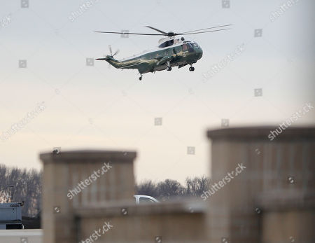 """Marine One, with President Donald Trump aboard, lands at Dover Air Force Base, Del. . Trump traveled to Dover AFB to meet with family members Chief of Special Warfare Operator William """"Ryan"""" Owens, 36, of Peoria, Ill, the U.S. service member who was killed in a raid in Yemen, and who's remains where returned today. Owens is the first-know combat death of a member of the U.S. military under Trump's administration"""
