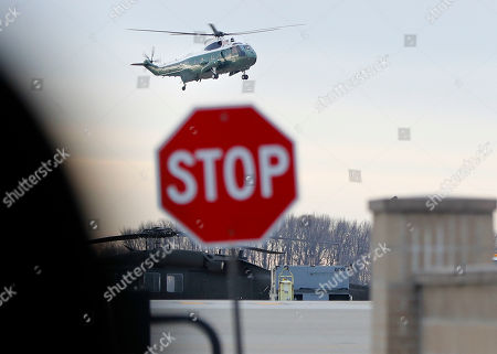 """Marine One, with President Donald Trump aboard, lands at Dover Air Force Base, Del., . Trump traveled to Dover AFB to meet with family members Chief of Special Warfare Operator William """"Ryan"""" Owens, 36, of Peoria, Ill, the U.S. service member who was killed in a raid in Yemen, and who's remains where returned today. Owens is the first-know combat death of a member of the U.S. military under Trump's administration"""