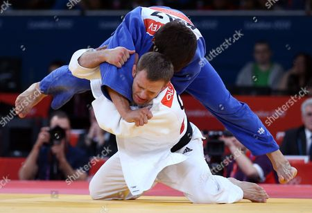 German Judoka Ole Bischof (in White) Fights Against Islam Bozbayev of Kazakhstan During the Preliminary Rounds of the London 2012 Olympic Games Judo Competition at the Excel Arena in London Britain 31 July 2012 United Kingdom London