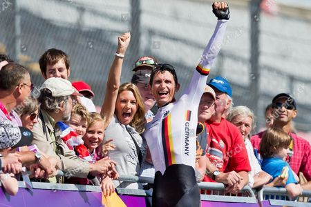 Michael Teuber (c) of Germany Celebrates with His Wife Susanne After Winning the Gold Medal in the Men's Individual C1 Time Trial of the Cycling Road Competitions at Brands Hatch During the London 2012 Paralympic Games in London Britain 05 September 2012 United Kingdom London