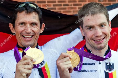 Michael Teuber (l C1) and Tobias Graf (r C2) of Germany Pose with Their Gold Medals After Winning Their Respective Men's Individual Time Trials of the Cycling Road Competitions at Brands Hatch During the London 2012 Paralympic Games in London Britain 05 September 2012 United Kingdom London