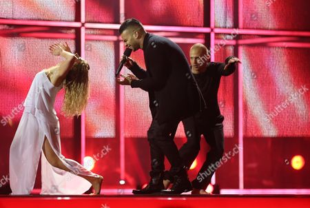 Stock Photo of Andras Kallay-saunders Representing Hungary Performs During Grand Final of the 59th Annual Eurovision Song Contest (esc) at the B&w Hallerne in Copenhagen Denmark 10 May 2014 Sixteen Countries Are Competing in the Grand Finale Denmark Copenhagen