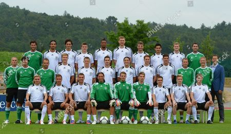 German National Soccer Team Members (back Row L-r) Fitness Trainer Yann-benjamin Kugel Sami Khedira Mats Hummels Toni Kroos Jerome Boateng Per Mertesacker Thomas Mueller Ilkay Gundogan Andre Schuerrle and Fitness Trainer Shad Forsythe; (middle Row L-r) Fitness Trainer Mark Verstegen Head Coach Joachim Loew Assistant Coach Hansi Flick Holger Badstuber Bastian Schweinsteiger Miroslav Klose Mesut Oezil Benedikt Hoewedes Mario Gomez Goalkeeper Coach Andreas Koepke Fitness Trainer Darcy Norman and Team Manager Oliver Bierfhoffl; (front Row L-r) Marcel Schmelzer Mario Goetze Lukas Podolski Goalkeeper Tim Wiese Goalkeeper Manuel Neuer Goalkeeper Ron-robert Zieler Philipp Lahm Marco Reus and Lars Bender Pose For Photographers in Tourettes France 29 May 2012 the German National Soccer Team is Preparing For the Uefa Euro 2012 Soccer Championship at Their Training Camp in Southern France France Tourrettes